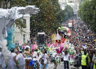Hundreds of thousands of participants dancing and having a good time on West London streets at Notting Hill Carnival 2011