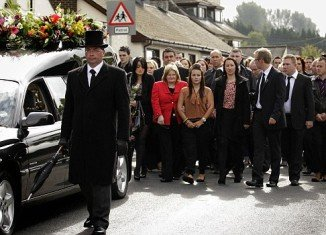 Shannon Graham (center) attended mother's funeral service in Northern Ireland this morning