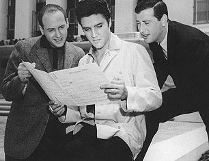 "Mike Stoller, Elvis Presley and Jerry Leiber studying ""Jailhouse Rock"" song sheet"
