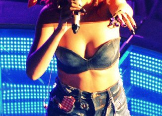 Rihanna is singing at V Festival 2011 (Photo shows Rihanna during Loud Tour)