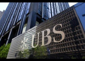 London police have arrested a man in connection with allegations of unauthorized trading which has cost Swiss banking group UBS an estimated $2 billion