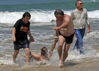 Michael Cohen was dragged on to Clovelly beach near Fish Hoek , then he was airlifted to hospital and is in a critical