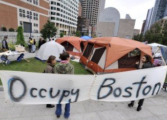 """""""Occupy Boston"""" demonstrators camping outside the Federal Reserve building"""