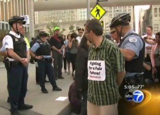 16 protesters were arrested in Chicago for misdemeanor trespassing at the Hyatt Regency protest, where a Mortgage Bankers Association conference was held