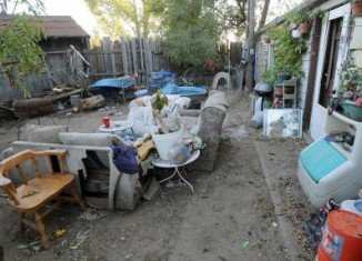 According to police, the boy's room was filled with junk and had a soiled mattress with no sheets