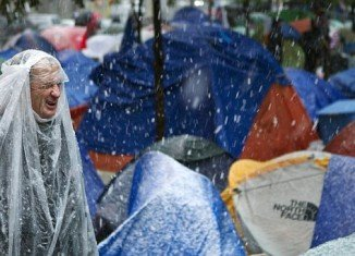 Occupy Wall Street protesters in New York City remained in their tents overnight despite the snowstorm and low temperatures which plunged below 40 degrees F