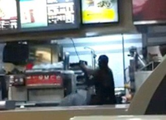 The video clip shows Rayon McIntosh, a Greenwich Village McDonald's cashier, viciously beating two women with a metal rod