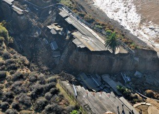 An enormous stretch of coastal road collapsed into the Pacific Ocean Sunday, and left a gaping hole where the road once was, after a large rainstorm in San Pedro