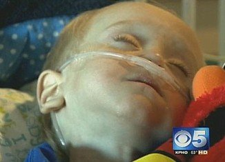 Emmett Rauch, a 2-year-old toddler from Arizona who swallowed a tiny battery, has undergone multiple surgeries as doctors struggle to save his life