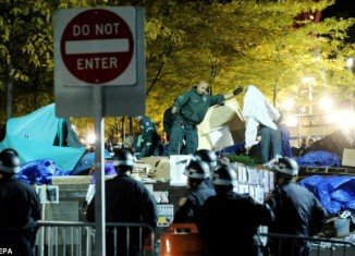 More than 70 protesters have been arrested early this morning as police mounted a raid on the Occupy Wall Street camp at Zuccotti Park in Manhattan, New York