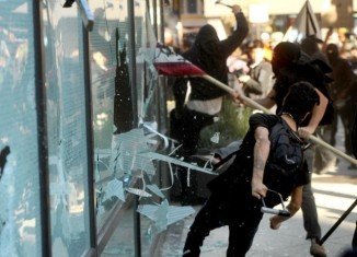 Occupy Oakland protesters shut down one of the nation's busiest shipping ports, vandalizing businesses and smashing bank windows