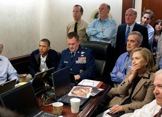 Strain etched on his face, Barack Obama watched as the raid to kill Osama Bin Laden played out on a television in front of him