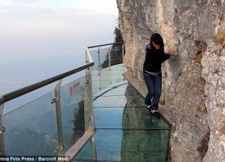 The oriental Skywalk is situated 4,700 ft above sea level on the side of the Tianmen Mountain in Zhangjiajie, China