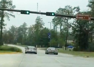 Two testosterone-fuelled Corvette drivers line up at a set of traffic lights and prepare to settle the best in a drag race in The Woodlands, Houston