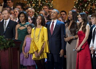 Obama family joined musical stars Justin Bieber, Cee Lo Green, Jennifer Hudson, Victoria Justice and The Band Perry at the 30th annual Christmas In Washington concert
