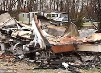 """Vicky Bell from Tennessee and her boyfriend stood helplessly by and watched their home and valuables go up in flames because a team of firefighters refused to help - as they had not paid their """"subscription fees"""""""