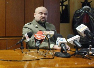 Colonel Mikolaj Przybyl shot himself today in dramatic footage caught on film in his office after cutting short a news conference