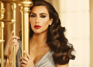Kim Kardashian unveiled a photo promoting her new perfume True Reflection inspired by Hollywood icon Elizabeth Taylor