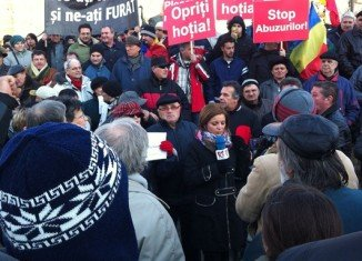 More than 1,000 protesters rallied in Bucharest's main University Square, blocking traffic