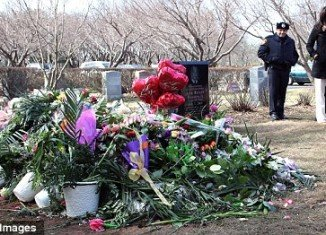 A day after Whitney Houston was buried at Fairview Cemetery in New Jersey her grave appeared covered by flower