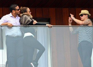 Jennifer Lopez and her manager, Benny Medina, in Rio de Janeiro posing for pictures that Casper Smart took