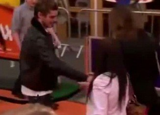 Zac Efron is seen approaching a fan to greet them, when he accidentally drops a condom on the red carpet at the premiere of his new Dr. Seuss film, The Lorax