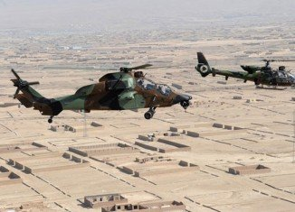 At least 12 Turkish soldiers and two children have been killed after a NATO helicopter has fallen on a house in Kabul