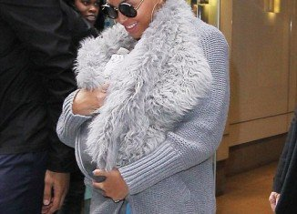 Beyonce matches her outfit to baby Blue Ivy's faux-fur sling