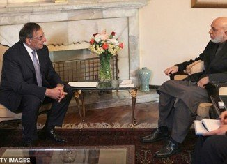 International security forces have to be taken out of Afghan villages, said President Hamid Karzai after meeting U.S. Defense Secretary Leon Panetta in Kabul