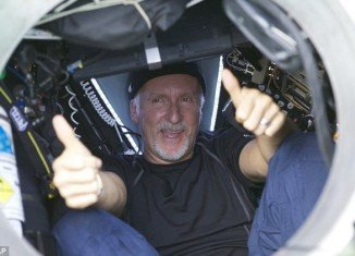 James Cameron has triumphantly resurfaced from the Earth's deepest point, Mariana Trench
