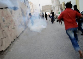 A man has been found dead with gunshot wounds after overnight clashes with police a day before Sunday's Bahrain F1 Grand Prix
