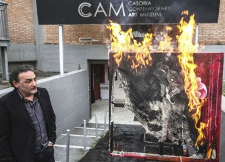 Casoria Contemporary Art Museum director Antonio Manfredi sets fire to a Severine Bourguignon painting