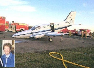Helen Collins remained calm as she brought the small Cessna plane in to land at Cherryland Airport, even though she said she knew her husband John was dead