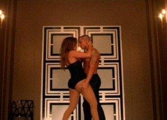 Jennifer Lopez's toy boy boyfriend Casper Smart couldn't resist grabbing his girlfriend's rear end several times in her new Dance Again video