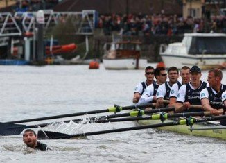 The 158th Oxford and Cambridge Boat Race on River Thames, UK, had to be halted midway through because of a swimmer