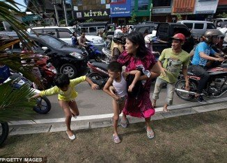 Tsunami alert caused panic among Indonesian people who fled buildings and made for high ground