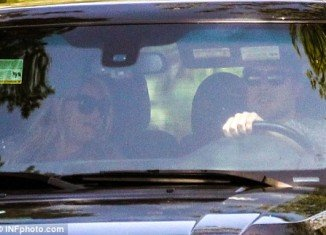 An overdue Jessica Simpson was yesterday spotted out for a drive with fiancé Eric Johnson
