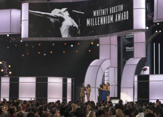 Bobbi Kristina was well-spoken and composed when it came to delivering her poignant speech, with Whitney Houston's sister-in-law and manager Pat Houston by her side, who also gave an introduction
