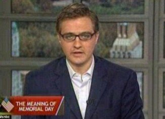 """Chris Hayes has caused outrage on Memorial Day by saying he feels """"uncomfortable"""" branding soldiers who have died in battle """"heroes"""