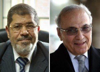 Egyptians will choose between Muslim Brotherhood's candidate Mohammed Mursi and Ahmed Shafiq, a candidate from the Mubarak-era regime, when the presidential election goes to a run-off