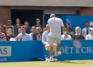 David Nalbandian was disqualified from the Aegon Championships final after injuring a line judge by kicking an advertising board into his shin