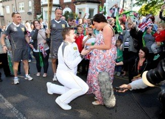 David State, 25, from Redcar, who works with the Scout movement and raises money for charity, knelt as he asked Christine Langham, 27, to marry him