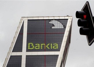 Eurozone finance ministers are to hold a conference call to discuss a bailout for Spanish banks