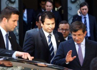 Foreign Minister Ahmet Davutoglu became the first senior Turkish official to challenge Syria's account of the downing of the jet