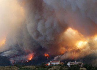 More than 32,000 people in Colorado Springs were forced to flee their homes as a raging wildfire threatening the city doubled in size overnight
