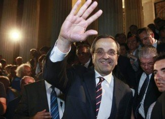 """New Democracy leader Antonis Samaras said Greeks had chosen to stay in the euro and called for a """"national salvation government"""""""