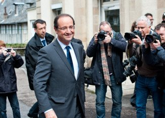 President Francois Hollande's Socialist Party has won enough seats in French parliament to form an absolute majority, according to exit polls