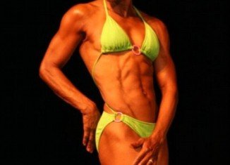 """Ruby Carter-Pikes, also known as """"Miss Ruby"""", is a great grandmother with a six pack that even a college athlete would be jealous of and a cabinet of bikini competition trophies to prove it"""
