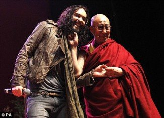 Russell Brand introduced the Dalai Lama during a youth event in Manchester yesterday and admitted he was finding the experience somewhat surreal