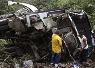 The bus slid off the road into a ravine in wet conditions while on its way to a rally in the town of Buenavista de Cuellar